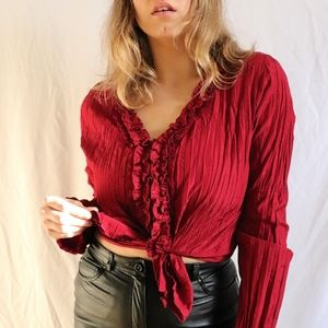 Red wrinkled button up shirt with lace and ruffles